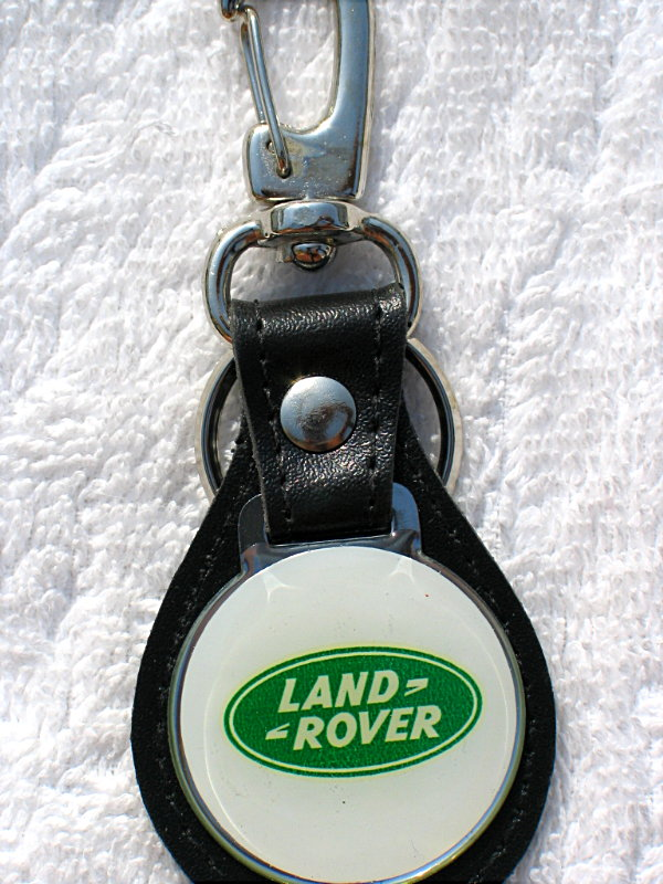 Land Rover Leather Keyring. DESC. (Each) Leather keyring with resin topped